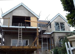 Front during renovation with deck and carport underneath